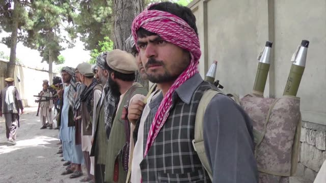 the commander known as pakhsaparan or the wall breaker and his bandolier draped fighters is part of a patchwork of anti taliban militias in northern... - bandolier stock videos & royalty-free footage