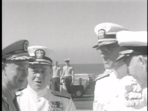 vídeos de stock e filmes b-roll de the commander of the uss miday welcomes the president of the people's republic of china chiang kai shek - uss midway