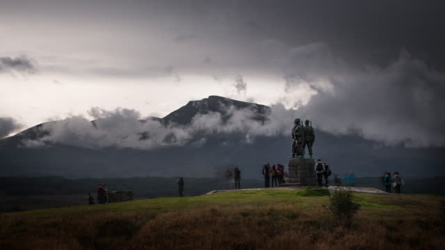 the commando memorial with views of the ben nevis range in the scottish highlands - scottish culture stock videos & royalty-free footage