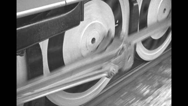 "vídeos y material grabado en eventos de stock de the ""commodore vanderbilt"" locomotive pulls the 20th century limited passenger train as it leaves chicago, rolling down track past camera / shot from... - 1930"