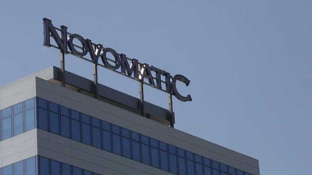 The company logo of Novomatic sits on top of the Novomatic AG headquarters in Gumpoldskirchen Austria on Thursday Aug 17 2017