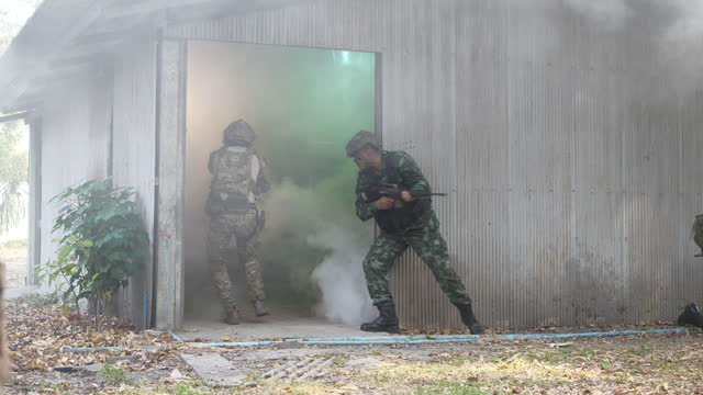 the concept of military training operations.a group of soldiers are invading to rescue the hostages at the safehouse with smoke. - infantry stock videos & royalty-free footage