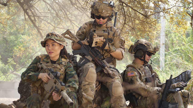 the concept of military training operations.army rangers during the military operation  sitting looking at the map - infantry stock videos & royalty-free footage