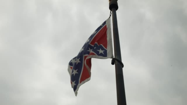 the confederate flag is seen flying on the south carolina capitol grounds june 23 2015 in columbia south carolina debate over the flag flying on the... - confederate flag stock videos & royalty-free footage