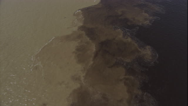 the confluence of the muddy amazon river and the clear, black rio negro creates a swirling pattern. available in hd. - 咖啡色 個影片檔及 b 捲影像