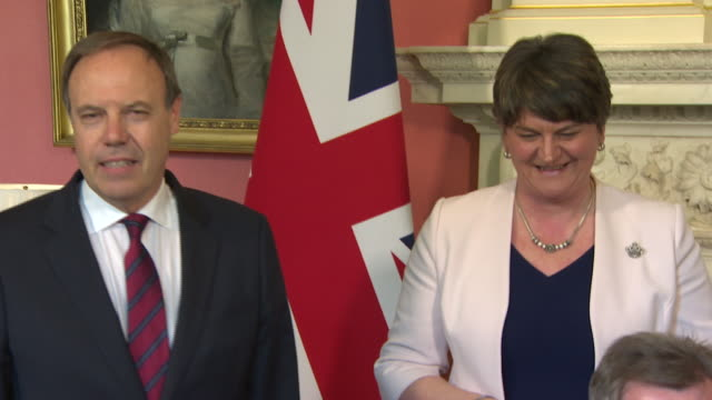 the conservative-dup deal being signed by sir jeffrey donaldson and gavin williamson - dup stock-videos und b-roll-filmmaterial