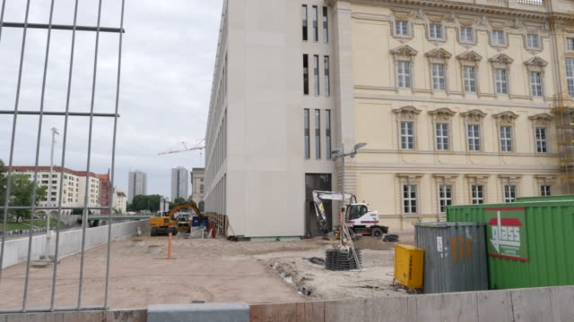 the construction site of the berlin city palace stands on june 16 2019 in berlin germany the berlin city palace in german called the 'berliner... - berliner stadtschloss stock-videos und b-roll-filmmaterial