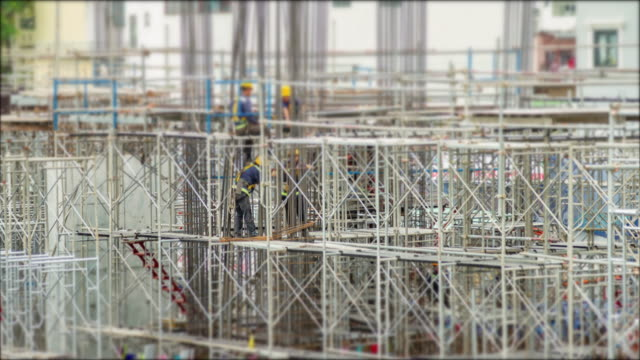 4k time lapse (4096x2160) : the construction site (apple prores. 422(hq)) - scaffolding stock videos & royalty-free footage