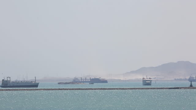 the container ship, the ever given, is seen from a village near the suez canal as ships wait to cross on march 28, 2021 in suez, egypt. the ship ran... - suez canal stock videos & royalty-free footage