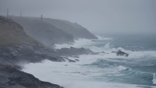 the continuing galeforce storms battering the british isles brought in large waves at pendeen watch in cornwall england uk wind gusts of over 50mph... - cornwall england stock videos & royalty-free footage