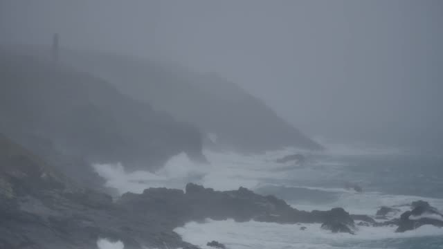 the continuing galeforce storms battering the british isles brought in large waves at pendeen watch in cornwall england uk wind gusts of over 50mph... - landscape stock videos & royalty-free footage