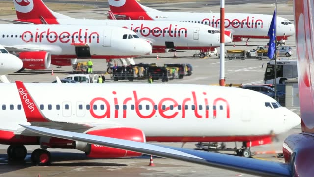 the control tower stands as air berlin aircraft sit on the tarmc at tegel airport operated by flughafen berlin brandenburg gmbh in berlin germany on... - flughafen stock videos & royalty-free footage