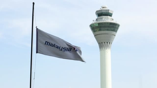 the control tower stands at kuala lumpur international airport in sepang malaysia on saturday july 19 flags fly at half mast in front of the control... - tower stock videos & royalty-free footage