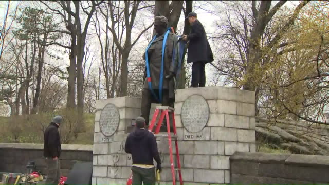 wpix the controversial statue of dr j marion sims was moved on april 17 from central park to the brooklyn cemetery where he was buried - soziale gerechtigkeit stock-videos und b-roll-filmmaterial