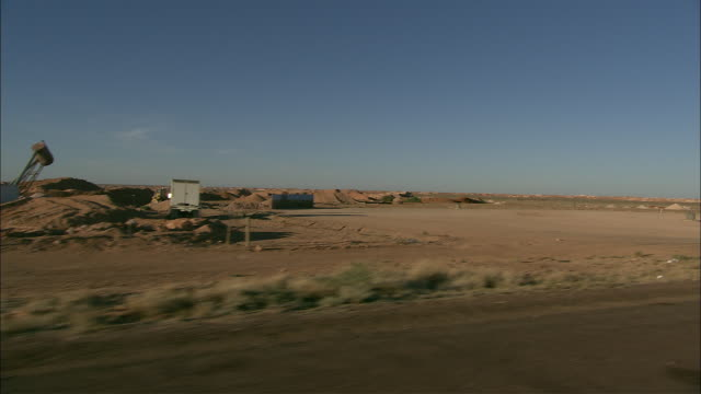 the coober pedy opal mines flow past from a vehicle's point of view. - coober pedy stock videos & royalty-free footage