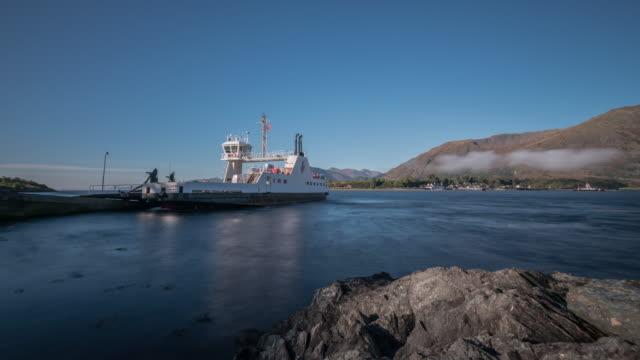 vídeos de stock, filmes e b-roll de the corran ferry crosses loch linnhe between nether lochaber to ardgour transporting vehicles and pedestrians - loch