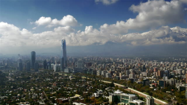 the costanera center and the city skyline with the andes in the distance - prosperity stock videos & royalty-free footage