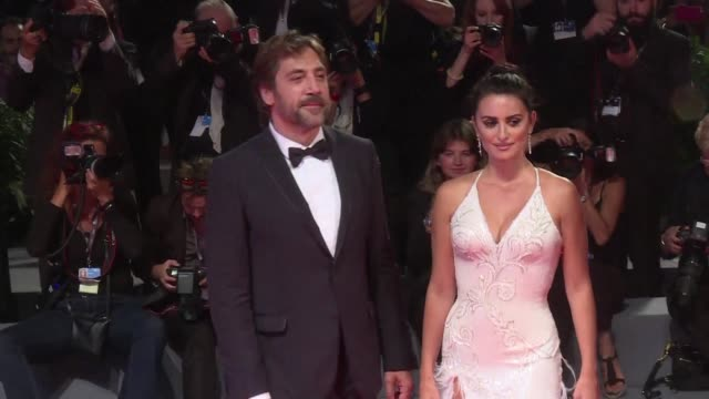 the couple javier bardem and penelope cruz light up the red carpet of the venice film festival after presenting out of competition the film loving... - javier bardem stock videos and b-roll footage