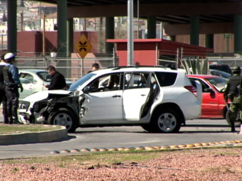 the couple was followed leaving a party killed a few feet from the us/mexico int'l bridge into el paso texas - drug cartel stock videos and b-roll footage