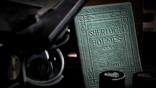 the cover of a decorative green copy of 'sherlock holmes' by arthur conan doyle - sherlock holmes stock videos & royalty-free footage