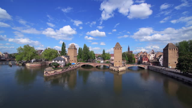 the covered bridges (also known as the ponts couverts) over the river ill in stasbourg, france. - strasbourg stock videos & royalty-free footage