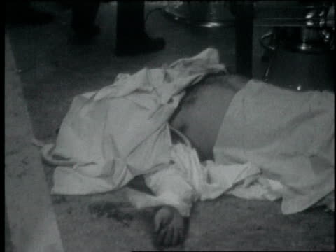 the covered dead body of mob boss albert anastasia on floor of barber shop at nyc's park sheraton hotel / cu hand of dead person sticking out of... - murder stock videos & royalty-free footage