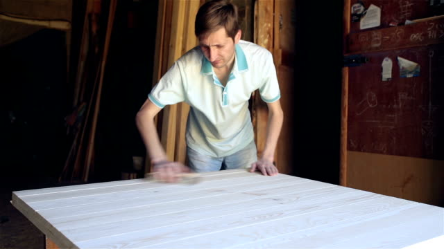 the craftsman processes the wooden surface of the future table. - polishing stock videos & royalty-free footage