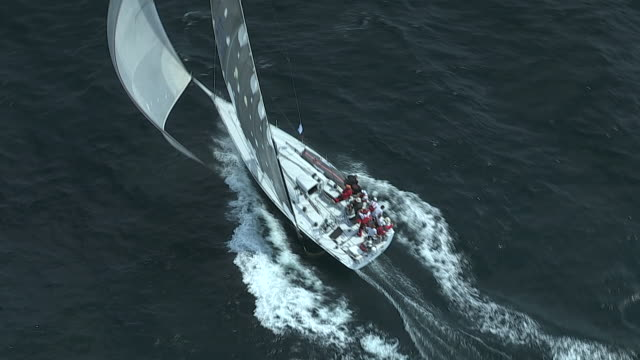 the crew aboard racing sailboat jazz usa 5299 displays teamwork at the start of the transatlantic race in narragansett bay. - regatta stock-videos und b-roll-filmmaterial