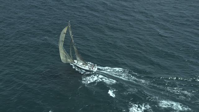 The crew aboard racing sailboat Zaraffa USA 16 displays teamwork in the TransAtlantic Race starting in Narragansett Bay.
