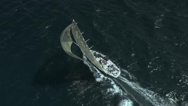 The crew aboard racing sailboat Zaraffa USA 16 repositions sail bags during the TransAtlantic Race.