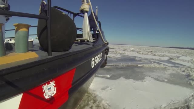 the crew aboard the 65foot coast guard cutter chock breaking ice in the chesapeake bay - bremskeil stock-videos und b-roll-filmmaterial