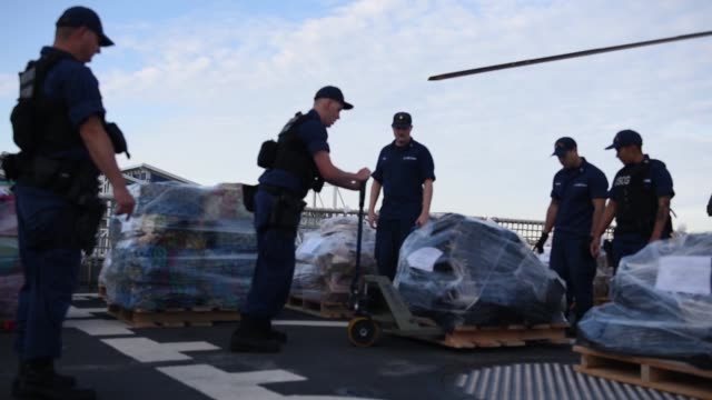 The crew of the Coast Guard Cutter Bertholf offloads more than 36000 pounds of suspected contraband at B Street Pier San Diego March 20 2018 The...