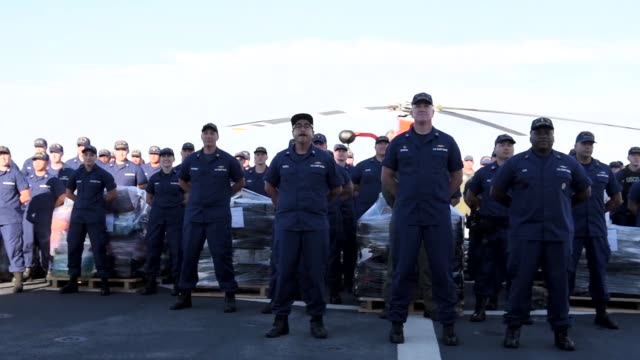 the crew of the coast guard cutter bertholf offloads more than 36000 pounds of suspected contraband at b street pier san diego march 20 2018 the... - guardia costiera video stock e b–roll