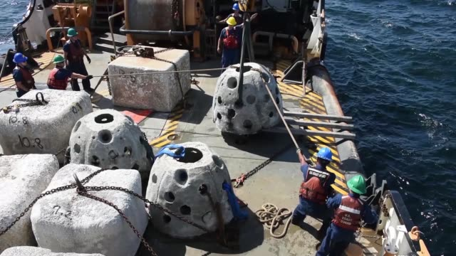 the crew of the coast guard cutter maria bray help create an underwater reef habitat by off-loading reclaimed concrete reef balls and old navigations... - hochziehen stock-videos und b-roll-filmmaterial