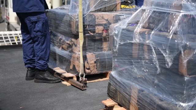 the crew of the coast guard cutter steadfast off load approximately 7800 kilograms of cocaine at san diego on july 16 2018 the contraband was seized... - trafficking stock videos and b-roll footage