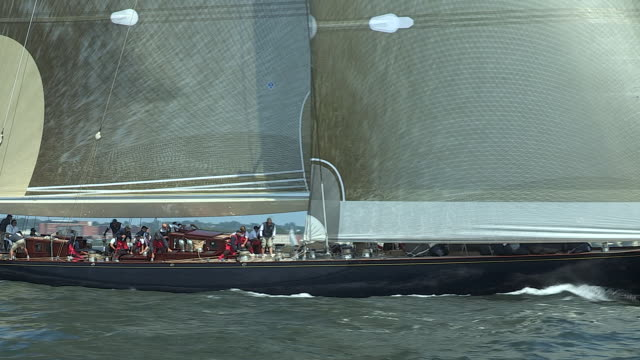 The crew of the J-Class yacht Velsheda tack her headsail while racing against the Ranger.