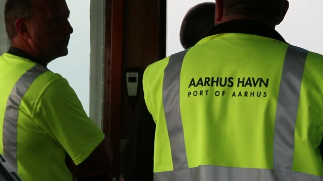 the crew of the tugboat hermes watch from the bridge as they guide the maersk mc kinney moller triple e class container ship operated by ap moeller... - crew stock videos & royalty-free footage