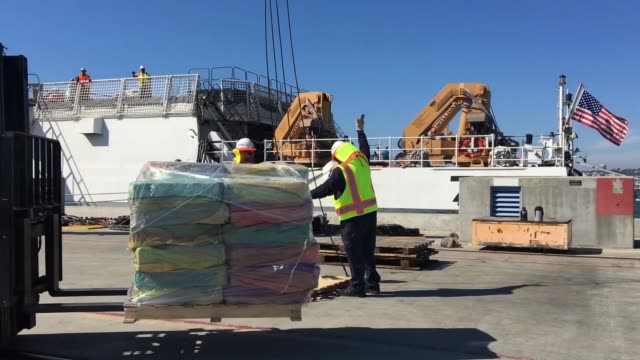 the crew of united states coast guard cutter munro offloads more than 39000 pounds of cocaine and 933 pounds of marijuana at vaval air station north... - currency symbol stock videos & royalty-free footage