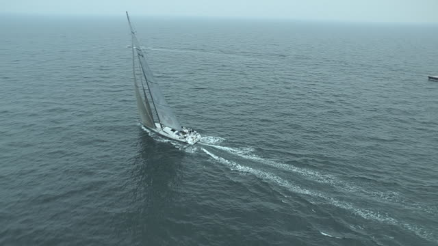 The crew on the giant racing yacht, ICAP Leopard, sail in a TransAtlantic Race near Newport, Rhode Island.