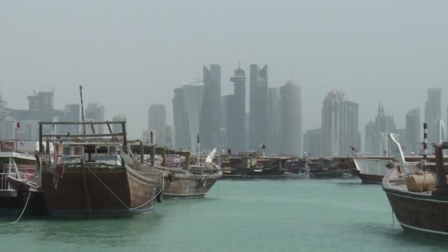the crisis that erupted a year ago between qatar and its neighbors led by saudi arabia has brought out a new gulf fractured and unstable while... - doha stock videos & royalty-free footage