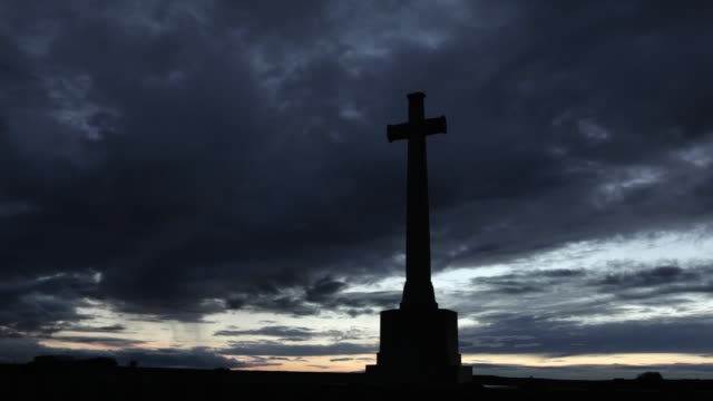 WS The Cross of Sacrifice at sunset at Louvencourt Military Cemetery on the Somme France From July 1915 to August 1916 field ambulances were...