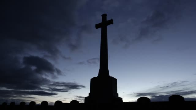 LS The Cross of Sacrifice at sunset at Louvencourt Military Cemetery on the Somme France From July 1915 to August 1916 field ambulances were...