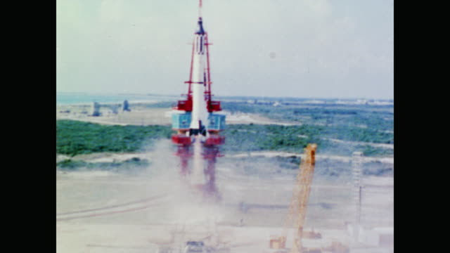 the crowd and press watch as the mercury-redstone 3 takes off from the launchpad making alan shepard the first american to enter space - 1961 stock videos & royalty-free footage