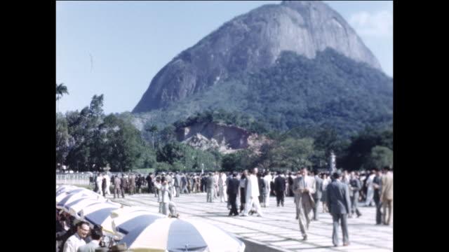 vídeos de stock, filmes e b-roll de the crowd at a horserace in brazil. - 1940