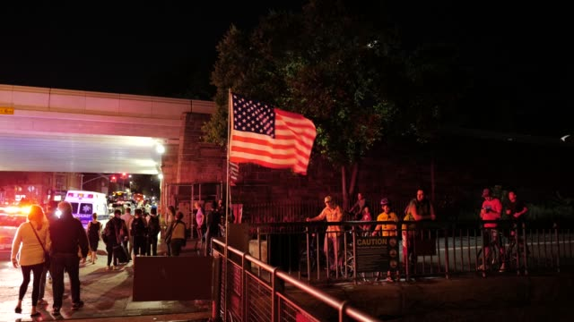 the crowd disperses at the conclusion of a 9/11 community vigil at the american veterans memorial pier on september 11, 2020 in bay ridge, brooklyn,... - gedenkveranstaltung stock-videos und b-roll-filmmaterial