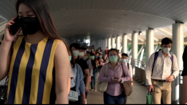 the crowd is wearing protective masks prevent coronavirus, covid 19 virus during virus outbreak and pm2.5 air pollution crisis rush hour bangkok, thailand - bangkok stock videos & royalty-free footage