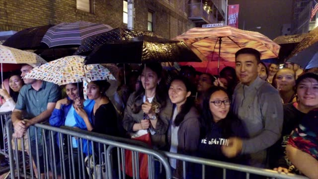 the crowd outside of the show hamilton sing the title song of the musical while waiting for lin manuel miranda's final performance to end at the... - musical theater stock videos and b-roll footage