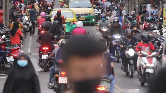 the crowded people on the road and traffic jam. - tourism stock videos & royalty-free footage