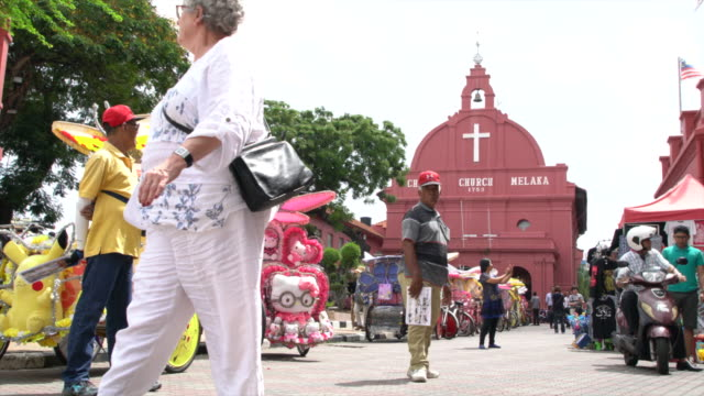 the crowded square in front of the red christ church, the city of malacca, malaysia - national landmark stock videos & royalty-free footage