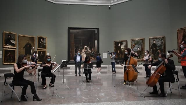 the crowds applauds are heard as a string quintet finishes performing 'ode to joy' while the prado museum opens again to the public on june 06, 2020... - five people stock videos & royalty-free footage